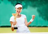 Pretty tennis player won the competition — Stock Photo