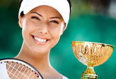 Successful tennis player won the cup — Стоковое фото