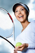 Female tennis player against the sky — Stock Photo