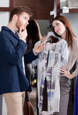 Woman asks her boyfriend to present her a dress — Stock Photo