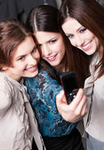 Girls snap themselves after shopping — Stock Photo