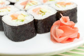 Sushi rolls on the white plate — Stock Photo