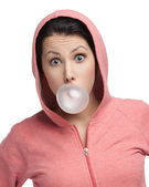 Female blows out pink bubble gum — Stock Photo
