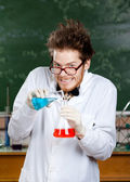 Mad professor pour blue liquid — Stockfoto