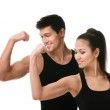 Two sportive in black showing biceps — Stock Photo
