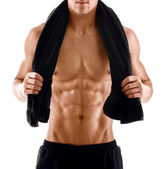 Sexy body of muscular man with towel — Stock Photo