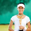 Professional female tennis player won the match — Stock Photo #13693146