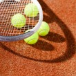 Постер, плакат: Close up view of tennis racket and balls
