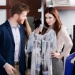 Woman insists that her boyfriend presents her a dress — Stock Photo