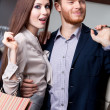 Wondered woman with her boyfriend is in the shop — Stock Photo