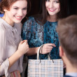 Shop assistant gives a piece of advice to clients — Stock Photo
