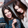 Happiness of two girlfriends after purchasing — Stock Photo