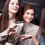 Women settles an account — Stock Photo #13693818