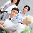 Businessman at the meeting with his female employees — Stock Photo #13694516