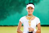 Professional female tennis player won the match — Stock Photo