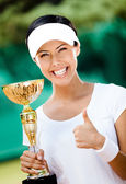 Successful female tennis player won the cup — Stock Photo