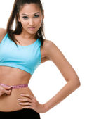 Sporty woman measures her waist — Stock Photo