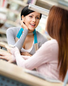 Two friends communicate sitting at the desk — Stock Photo