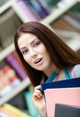 Wondered female student with books — Stock Photo