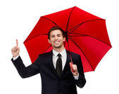 Forefinger gesturing man with opened red umbrella — Stock Photo