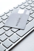 Close up view of credit card on a laptop keyboard — Stock Photo