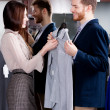 Consulting with girlfriend while selecting a shirt — Stock Photo #13865207