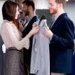 Stock Photo: Consulting with girlfriend while selecting shirt