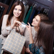 Women take away purchases — Stock Photo