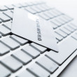Close up view of credit card on a computer keyboard — Stock Photo #13866028