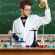 Mad professor examines Bunsen flask — Stock Photo