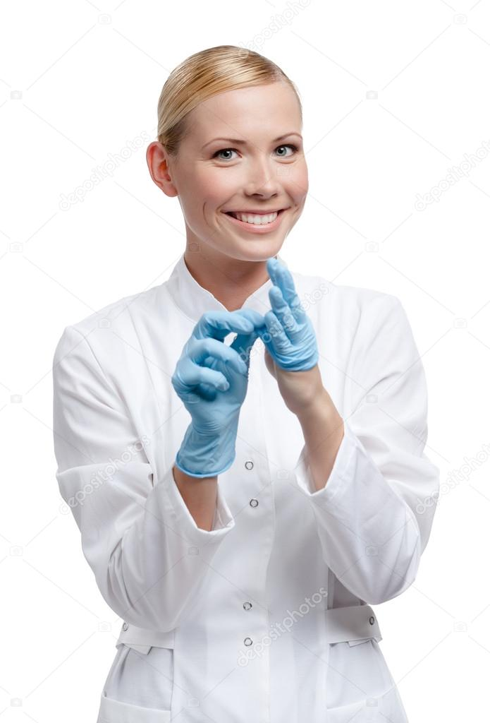 Practitioner puts off the medical blue gloves, isolated on white — Stock Photo #13866085