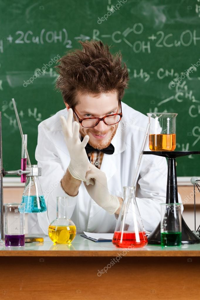 Putting rubber gloves mad professor is in his laboratory — Stock Photo #13866439