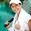 Stock Photo: Young female tennis player with towel on her shoulders