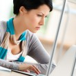 Female student works on the laptop — Stock Photo #14049603