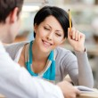 Woman talks with man at the library — Stock Photo #14049668