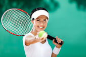 Sporty woman serves tennis ball — Stock Photo