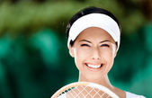 Close up of happy woman with tennis racket — Stockfoto