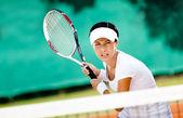 Successful sportswoman in sportswear playing tennis — Stock Photo