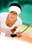 Athletic woman in sportswear playing tennis — Stock Photo