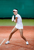 Young female player at the clay tennis court — Stok fotoğraf
