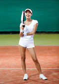 Professional female player at the clay tennis court — Stock Photo