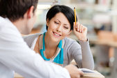 Woman talks with man at the library — Stock Photo