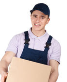 Workman in overalls keeps a parcel — Stock Photo