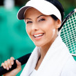 Stock Photo: Professional female tennis player with towel on her shoulders