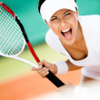 Sportswoman in sportswear playing tennis - Stok fotoğraf