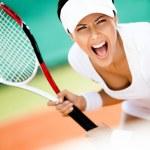 Sportswoman in sportswear playing tennis — Stock Photo