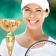 Young female tennis player won cup — Stock Photo #14339069