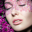 Close up portrait of model makeup with eyes shut - Stock Photo