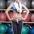 Loosing weight woman in fitness gym — Stock Photo