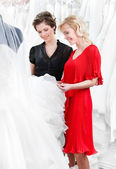 Choosing wedding dress at the bridal salon — Stok fotoğraf